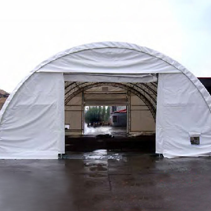 Large Area Maintenance Shelter : Crestline truss arch fabric structure